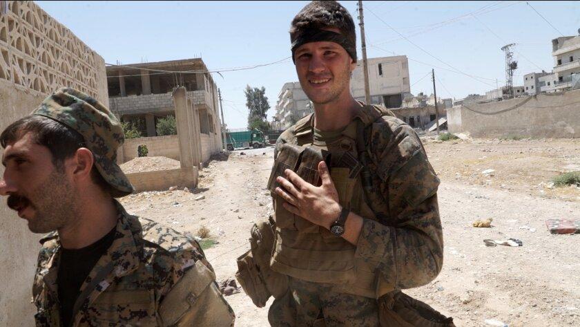 Levi Shirley, right, in Manbij, Syria, where he fought alongside Kurdish rebels against Islamic State.