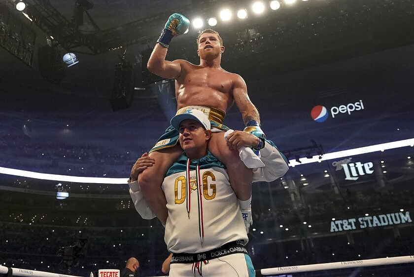 Canelo Alvarez celebrates after defeating Billy Joe Saunders in a unified super middleweight world championship boxing match, Saturday, May 8, 2021, in Arlington, Texas. (AP Photo/Jeffrey McWhorter)