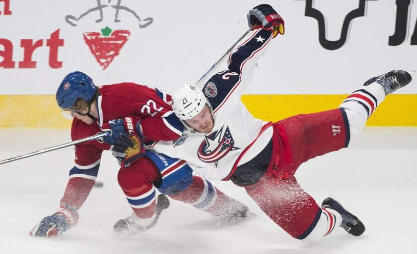 Montreal Canadiens' Dale Weise, left, collides with Columbus Blue Jackets' James Wisniewski during the second period of an NHL hockey game, Saturday, Feb. 21, 2015 in Montreal. (AP Photo/Canadian Press, Graham Hughes)