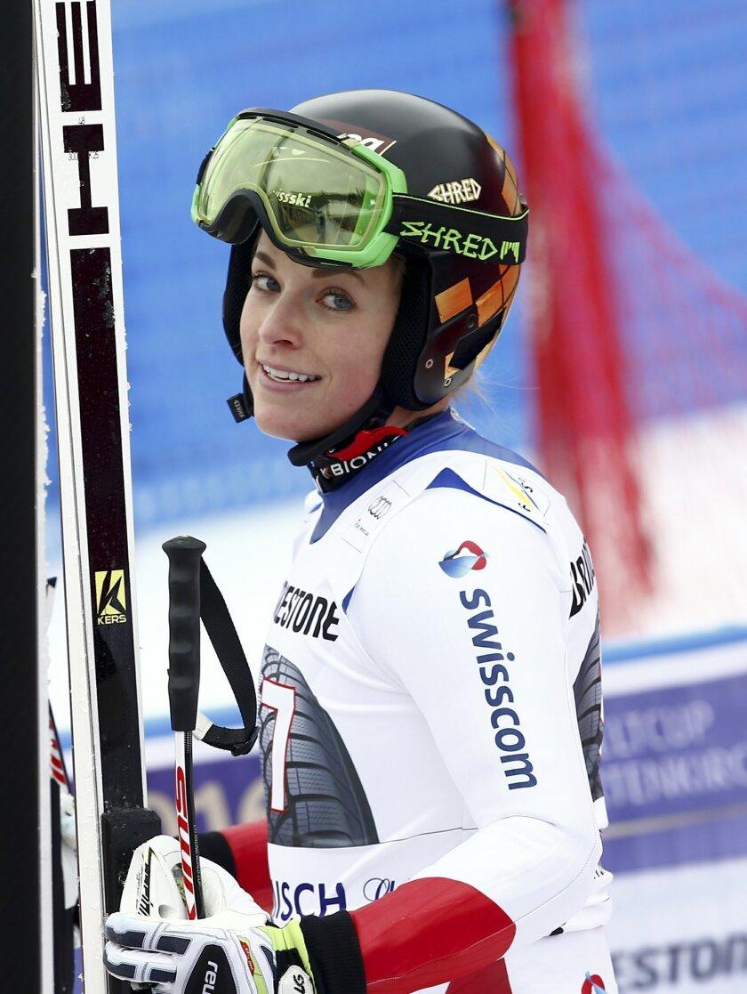 Switzerland's Lara Gut smiles at the finish area after completing an Alpine Ski women's World Cup Super G race, in Garmisch Partenkirchen, Germany, Sunday, Feb. 7, 2016. (AP Photo/Gio Auletta)