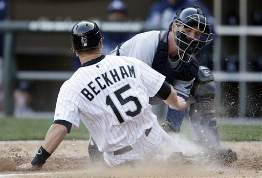Tampa Bay Rays catcher John Jaso, right, tags out Chicago White Sox's Gordon Beckham during the seventh inning of a baseball game in Chicago, Saturday, April 9, 2011. The White Sox won 4-2. (AP Photo/Nam Y. Huh)