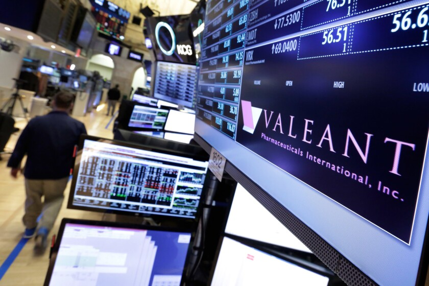 A trading post on the floor of the New York Stock Exchange displays the Valeant Pharmaceuticals logo on March 15.