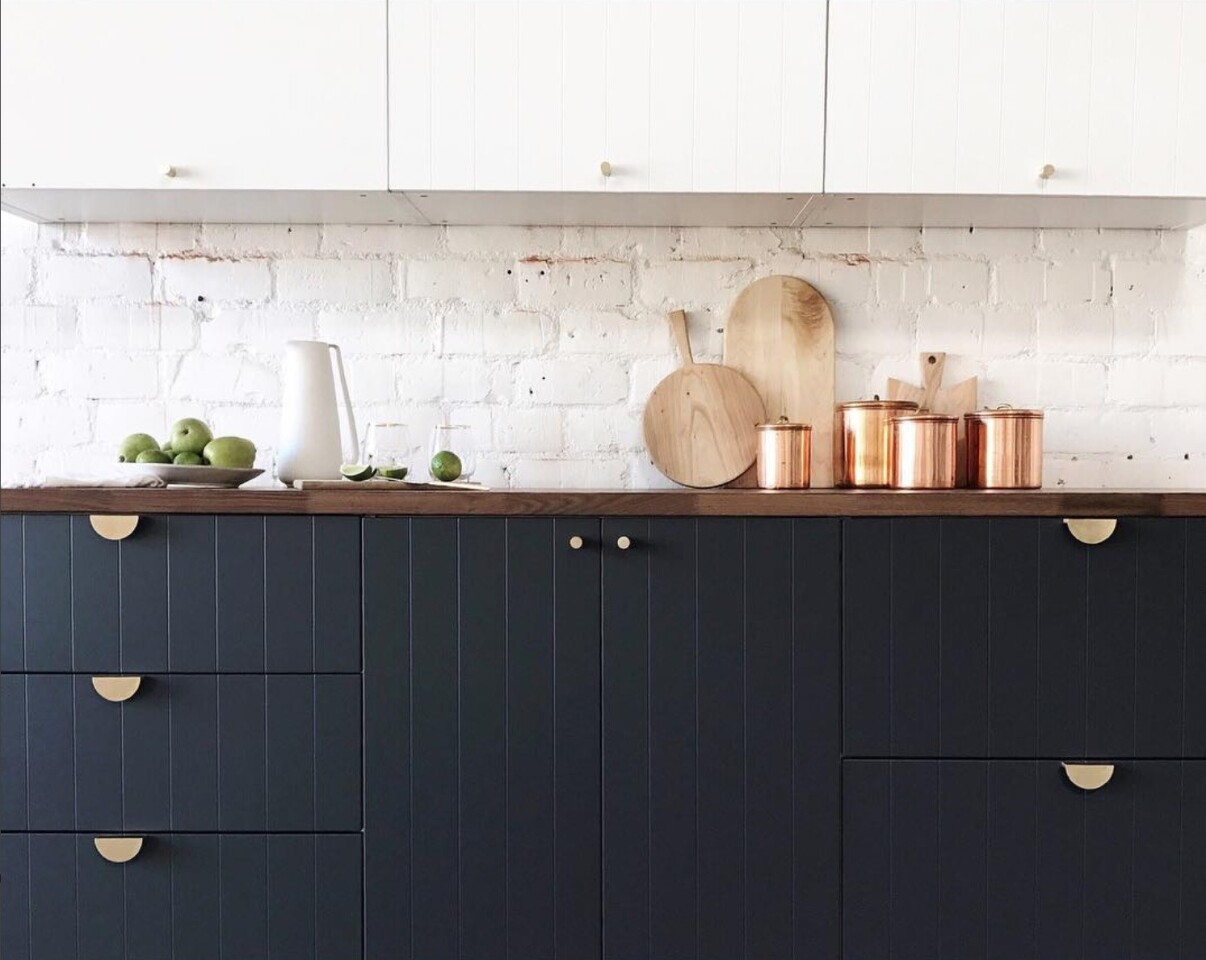 Classic beadboard cabinet doors by Sarah Sherman Samuel are paired with Ikea cabinets to create a custom kitchen. The new line from Semihandmade coordinates with IKEA kitchen, bath and media cabinets.