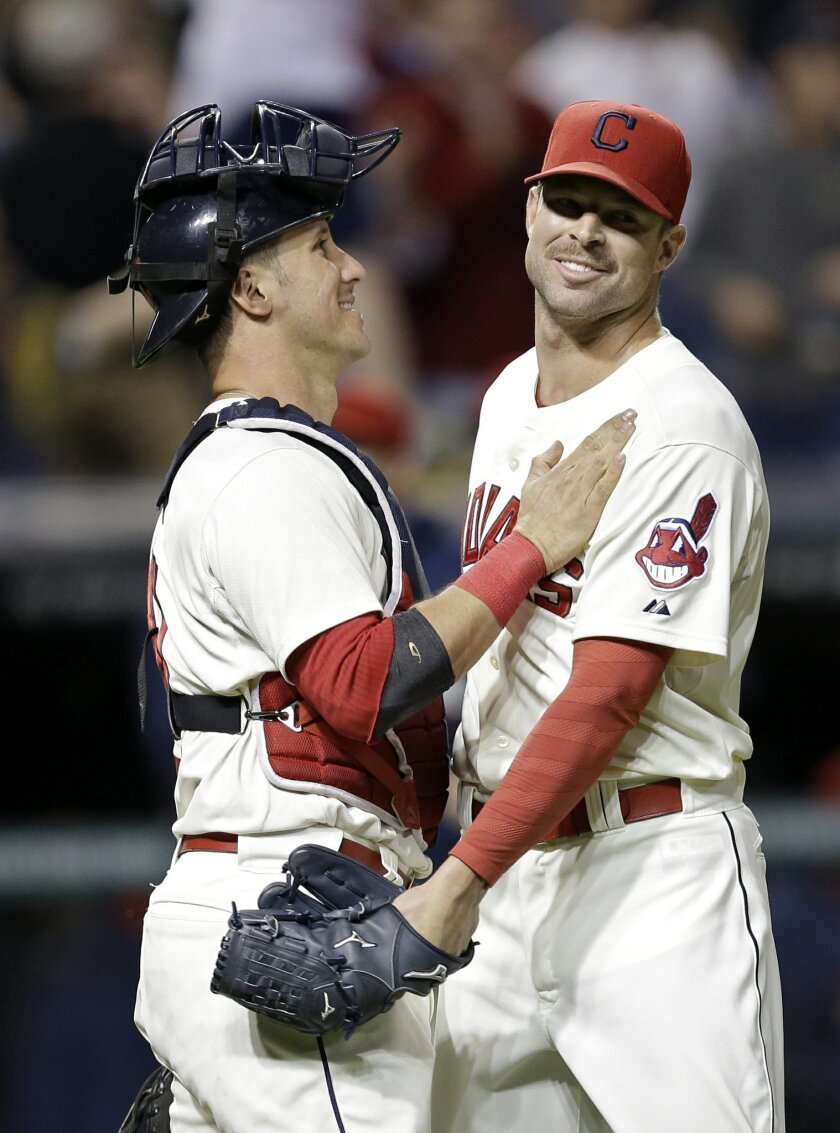 Cleveland Indians starting pitcher Corey Kluber, right, is congratulated by catcher Yan Gomes after the Indians defeated the Chicago White Sox 3-1 in a baseball game Saturday, Sept. 6, 2014, in Cleveland. Kluber threw a five-hitter. (AP Photo/Mark Duncan)