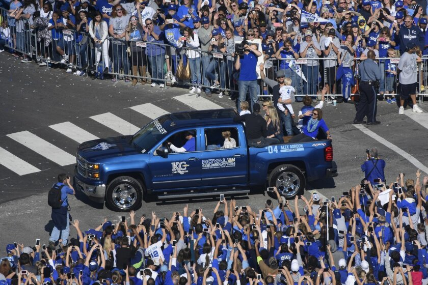 Kansas City Royals' Alex Gordon waves to the crowd during a parade to celebrate the Royals winning baseball's World Series Tuesday, Nov. 3, 2015, in Kansas City, Mo. The Royals beat the New York Mets in five games to win the championship. (AP Photo/Reed Hoffmann)