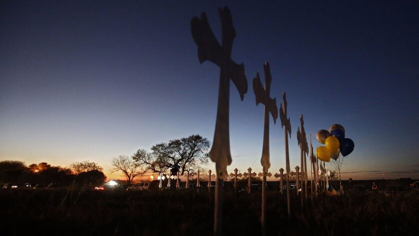 Twenty-six crosses stand on a field, representing the 26 victims of the shooting, at the First Baptist Church in Sutherland Springs, Texas.