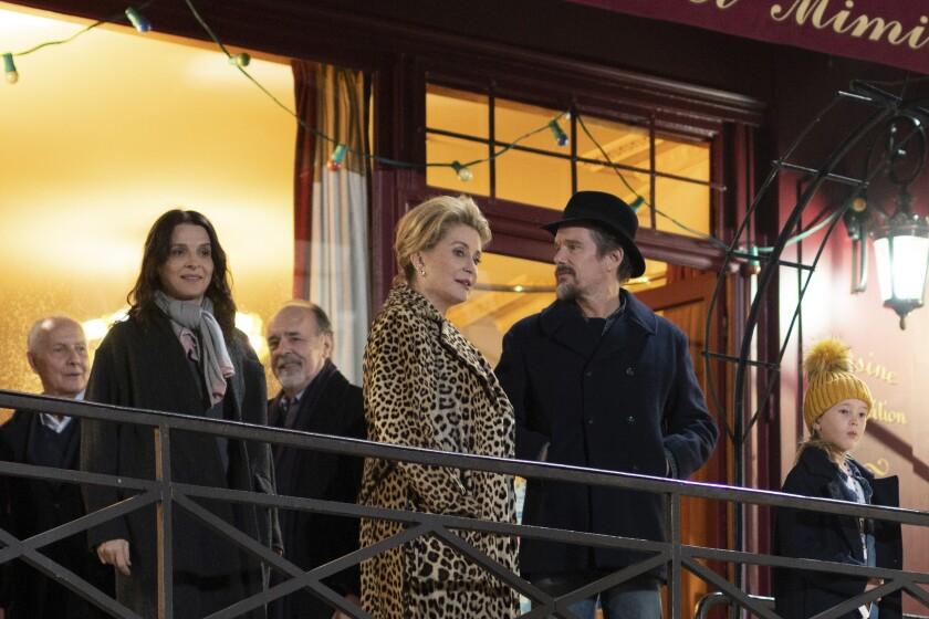 """This image released by IFC Films shows, foreground from left, Juliette Binoche, Catherine Deneuve, Ethan Hawke and Clémentine Grenier in a scene from """"The Truth."""" (IFC Films via AP)"""