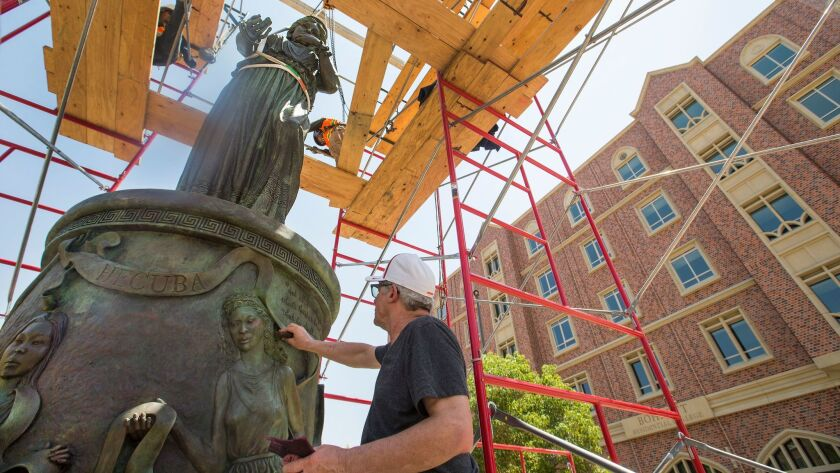 Christopher Slatoff makes some finishing touches on his sculpture at USC.