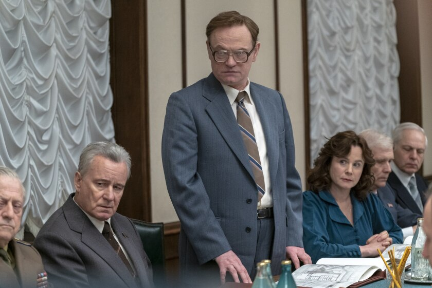 """In a scene from HBO's """"Chernobyl,"""" from left, Stellan Skarsgard, Jared Harris and Emily Watson."""