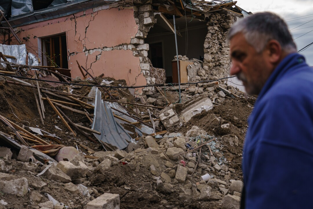 David Safaryan, 63, looks over the rubble of a destroyed home after a military strike in a residential neighborhood.