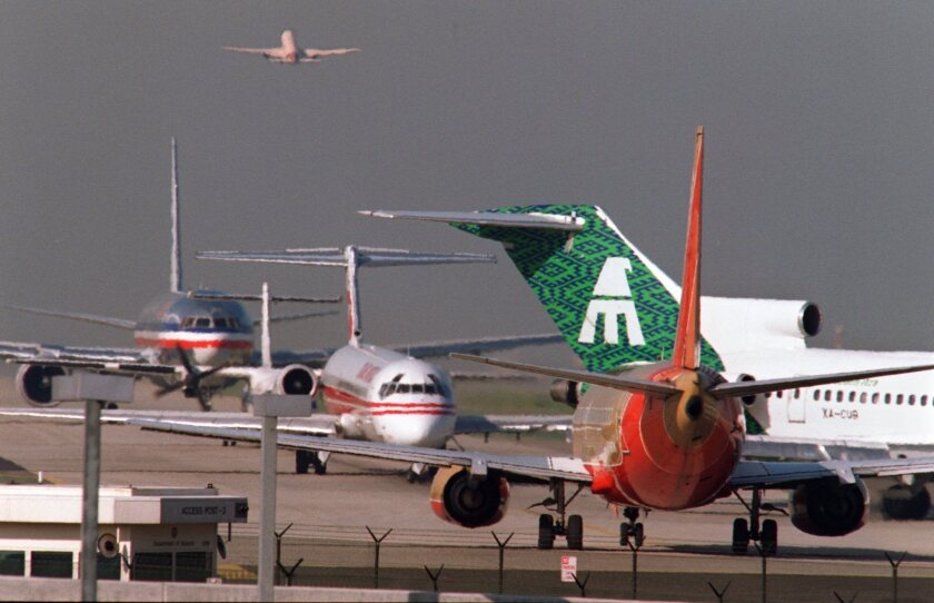 Planes line up on the north runway waiting to take off at Los Angeles International Airport. Airlines generate about 3% of carbon dioxide emissions in the U.S., according to an environmental group.
