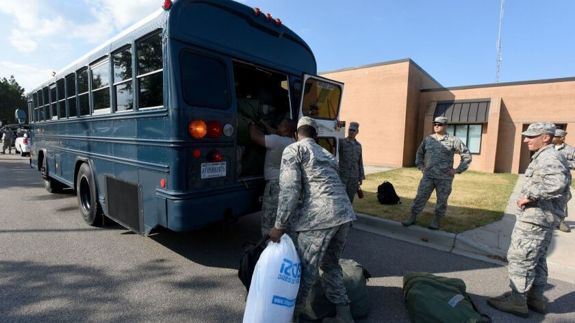 U.S. Air National Guard from the South Carolina Air National Guard and 169th Fighter Wing prepare on Monday to deploy to support civilian agencies in advance of Hurricane Florence. Home improvements stores saw their shares rise as the hurricane was expected to boost sales.