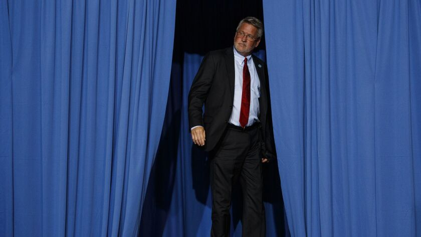The man behind the curtain: White House communications director Bill Shine offstage Oct. 2 a Trump rally in Southaven, Miss.