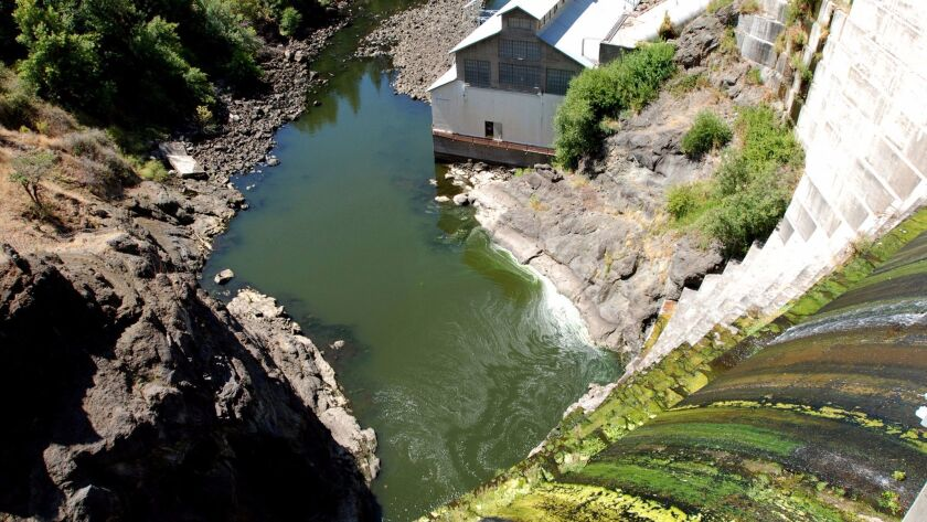 Water trickles over Copco 1 Dam on the Klamath River outside Hornbrook, Calif. on Aug. 21, 2009.