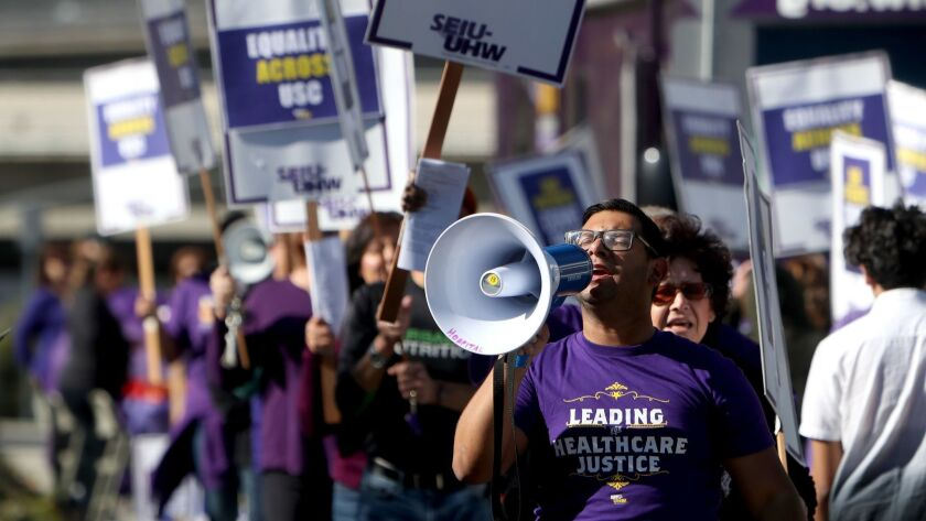 SEIU-UHW staffer Jose Abastida and union members picket for contract resolution outside Verdugo Hill