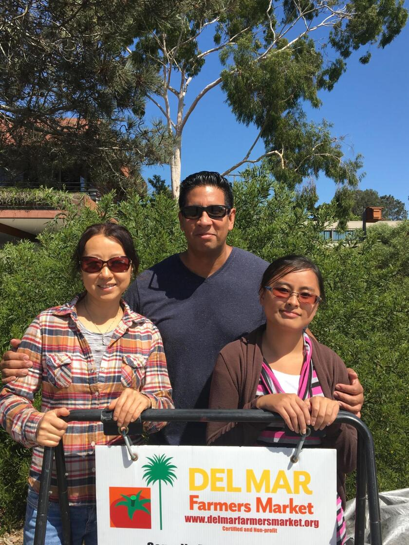 "Del Mar Farmers Market scholarship recipients Qing ""Clarissa"" Wang, Fabian Huertas, May Nou Nhiayi."