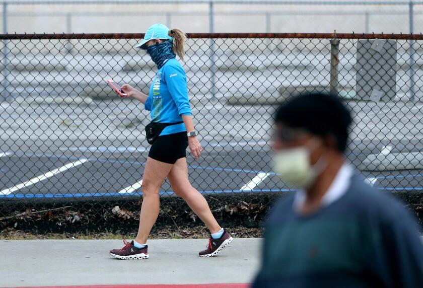 Two pedestrians in Burbank practicing social distancing