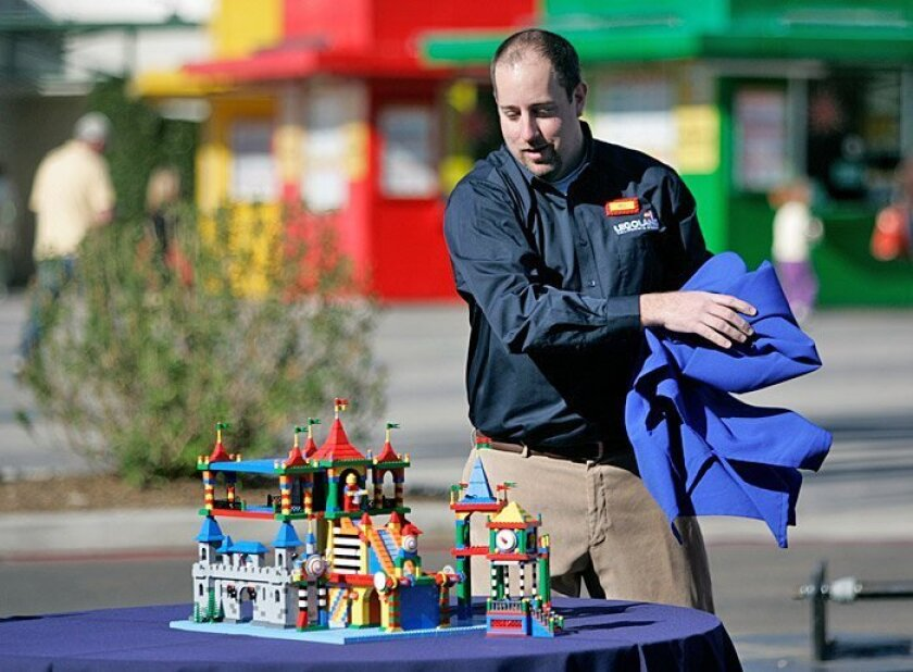 Project designer Bill Vollebrecht unveiled the miniaturized Lego inspiration for a new water park during a news conference at Legoland in Carlsbad on Friday.