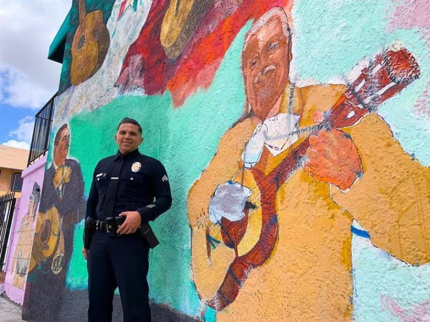 """Chris Reza is known in Boyle Heights as the """"mariachi policeman."""" Reza, a detective with the Los Angeles Police Department, told EFE on March 13, 2019, that he uses music to """"break the ice"""" with the public and to strengthen community relations. """"The idea is to humanize the badge,"""" Reza told EFE in Mariachi Plaza, located just a short distance from his workplace and where he has performed with his band - Mariachi Los Servidores - made up of police officers from Southern California. EFE-EPA/ Eugene Garcia"""