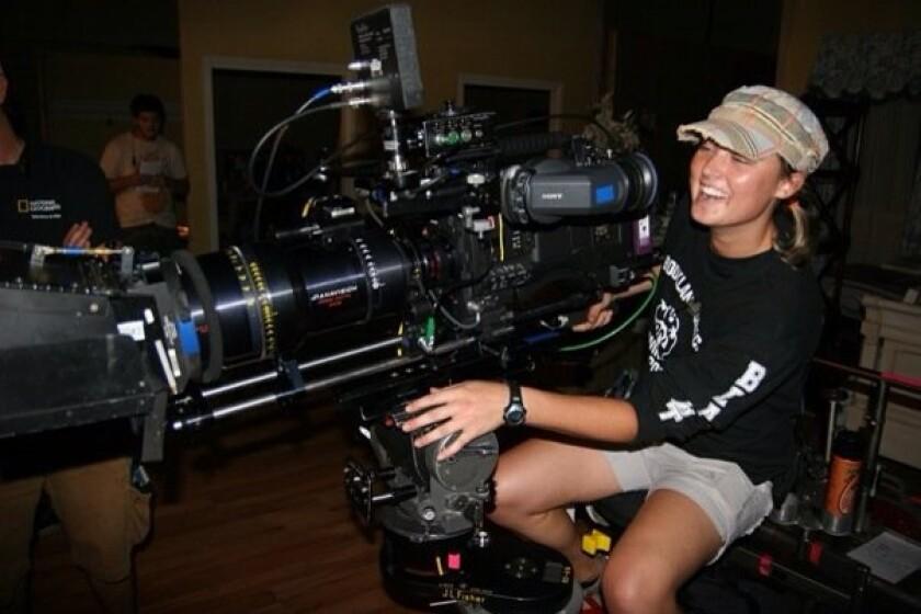 Sarah Jones operates a film camera.