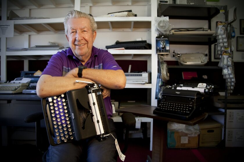 Ott Ernst, who repairs typewriters at Stearns Business Machines in Oceanside holds a recently fully restored Royal typewriter.