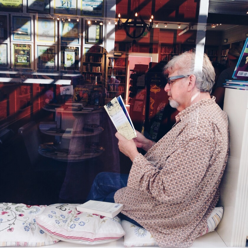 A reader in the window of the DIESEL, A Bookstore in Brentwood. The book store will open in Carmel Valley on Oct. 28.