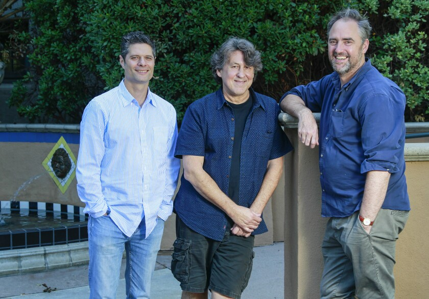"""Almost Famous"" composer-lyricist Tom Kitt, writer-lyricist Cameron Crowe and director Jeremy Herrin (from left), photographed in Balboa Park."