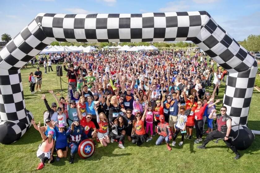 TParticipants at a past Miracle Babies Superhero 5K event.