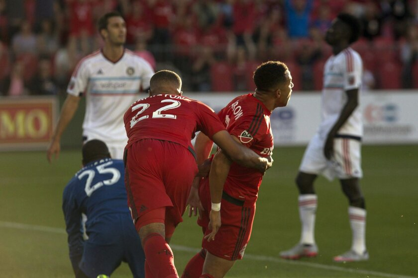 Toronto FC defender Justin Morrow, front right, celebrates with teammate Jordan Hamilton after scoring his team's opening goal during first-half MLS soccer game action against the Chicago Fire in Toronto, Saturday, July 9, 2016. (Chris Young/The Canadian Press)