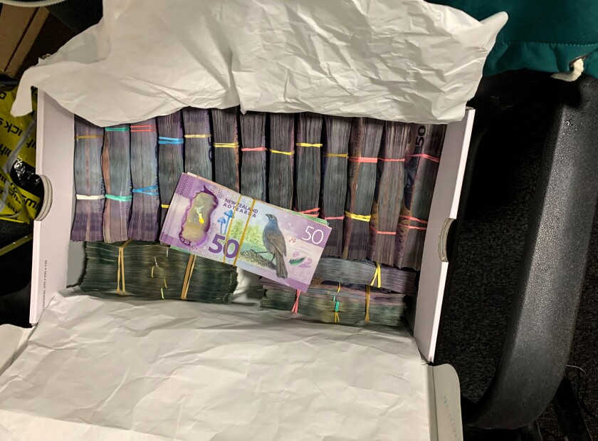 a box containing a large amounts of cash