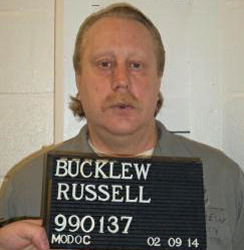 "FILE - This undated file photo provided by the Missouri Department of Corrections shows Russell Bucklew. Bucklew is scheduled to die by injection Oct. 1, 2019 for killing a southeast Missouri man during a violent crime rampage in 1996. Bucklew suffers from a rare medical condition that causes blood-filled tumors in his head, neck and throat, and he had a tracheostomy tube inserted in 2018. His attorneys say he faces the risk of a ""grotesque execution process."" Missouri Gov. Mike Parson, who is considering clemency in the execution for tomorrow. (Missouri Department of Corrections via AP File)"