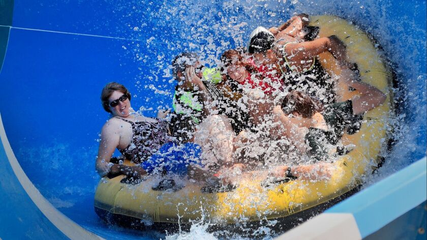 NEWPORT BEACH, CALIF. -- THURSDAY, JULY 5, 2018: Amid temperatures in the 90's, a group gets soaked