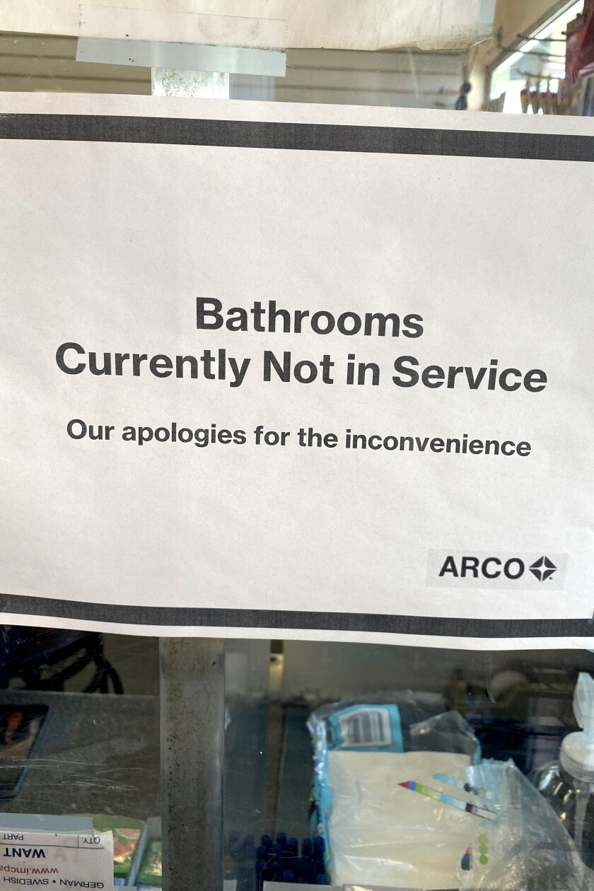 """Bathrooms currently not in service"" sign at Arco in Compton on April 8, 2020."