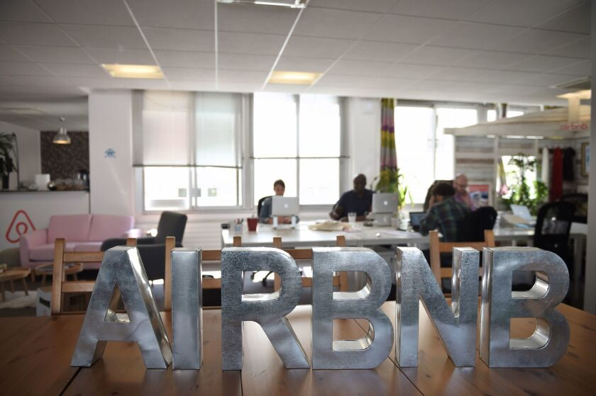 Workers run Airbnb's business from offices in Paris.