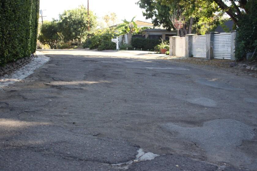 Potholes and uneven surfaces mark Calle Majorca in La Jolla.
