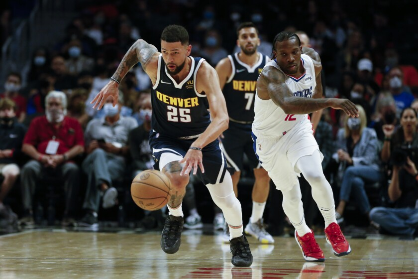 Denver Nuggets guard Austin Rivers takes the ball away from Clippers guard Eric Bledsoe.