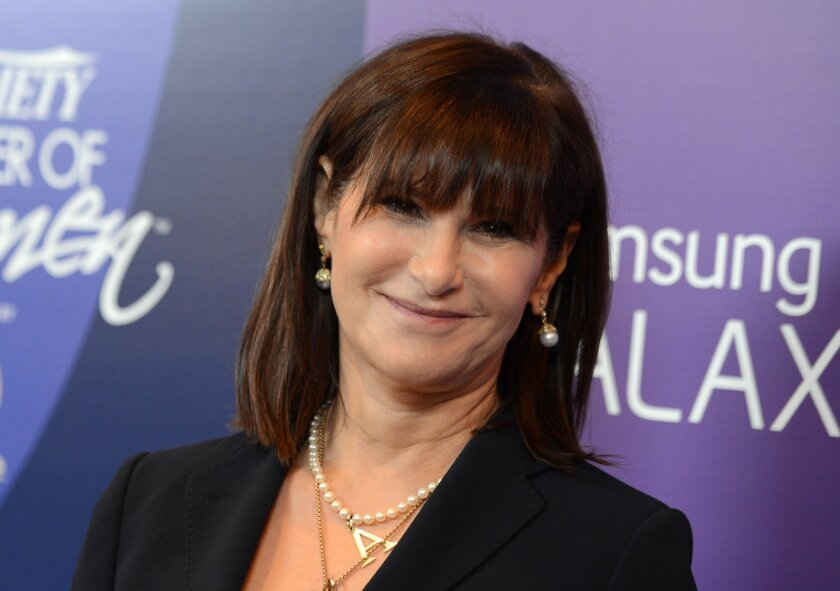 FILE - In this Oct. 4, 2013 file photo, Amy Pascal, Sony Pictures Entertainment co-chairman, arrives at Variety's 5th Annual Power of Women event at the Beverly Wilshire Hotel in Beverly Hills, Calif. Sony on Thursday, Feb. 5, 2015 announced that Pascal will step down as co-chairman of Sony Pictures Entertainment and head of the film studio, nearly three months after a massive hack hit the company and revealed embarrassing emails. (Photo by Jordan Strauss/Invision/AP, File)