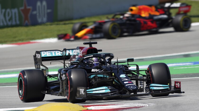 Mercedes driver Lewis Hamilton of Britain takes a curve followed by Red Bull driver Max Verstappen of the Netherlands, in the background, during the third free practice for the Spanish Formula One Grand Prix at the Barcelona Catalunya racetrack in Montmelo, just outside Barcelona, Spain, Saturday, May 8, 2021. The Spanish Grand Prix will be held on Sunday. (AP Photo/Emilio Morenatti)