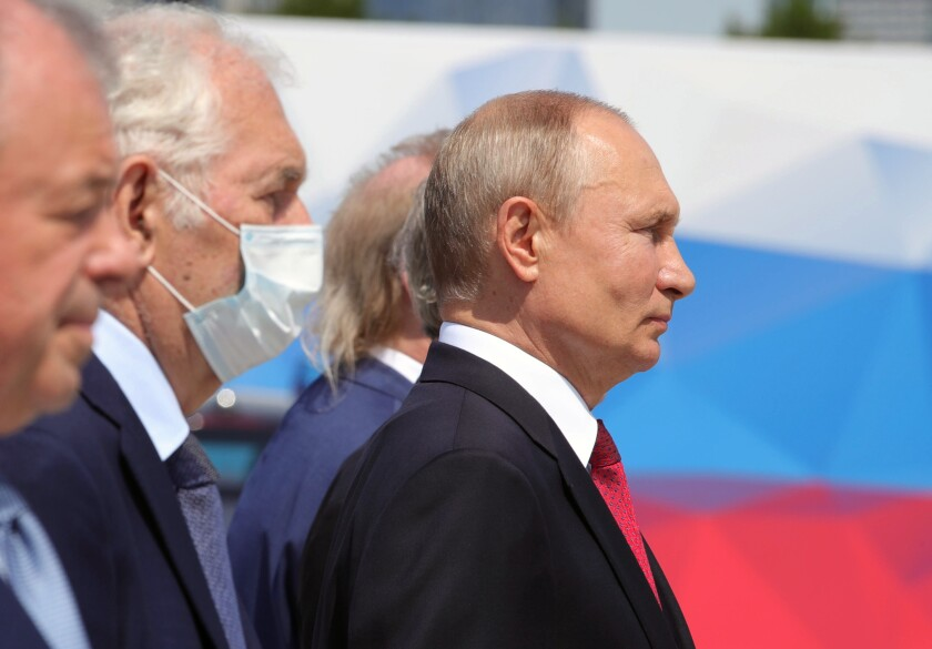 Russian President Vladimir Putin, right, attends a ceremony in Moscow to recognize heroes of labor.