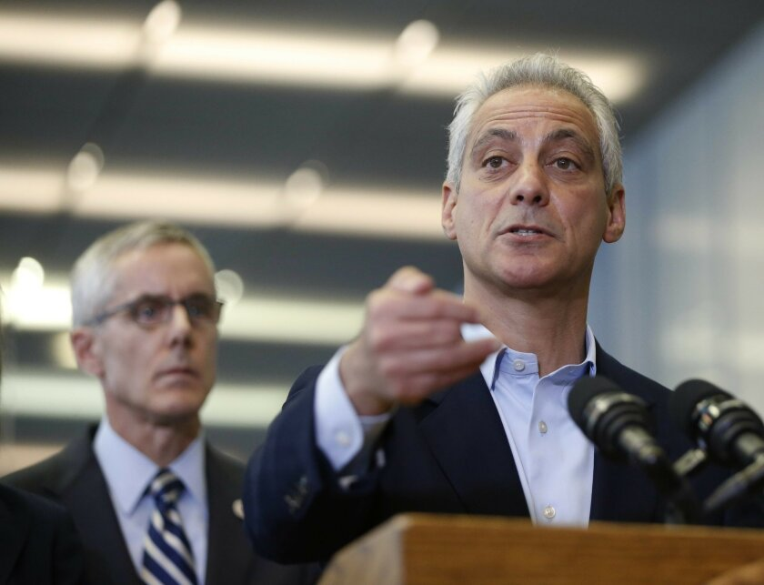 Chicago Mayor Rahm Emanuel, right, responds to a question related to the massive delays at airport security lines across the country, as Transportation Security Administration chief Peter Neffenger listens Friday, May 20, 2016, in Chicago. (AP Photo/Charles Rex Arbogast)