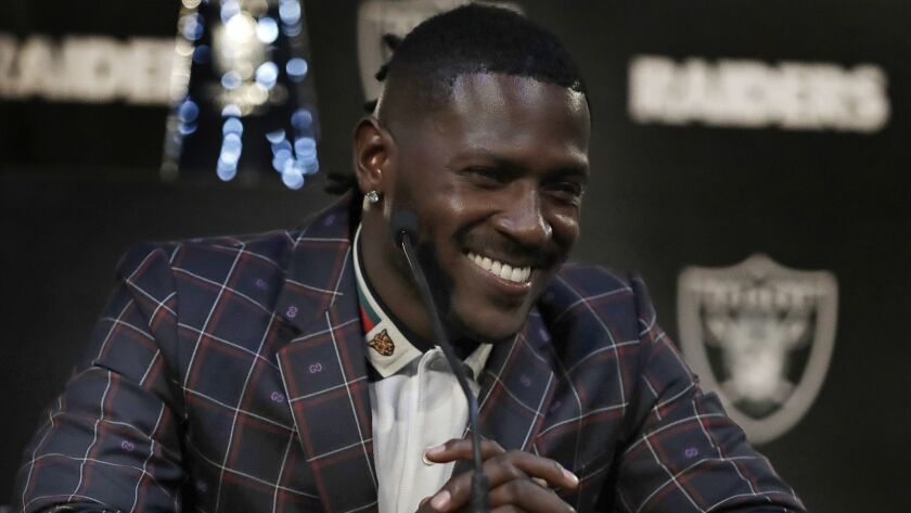 Oakland Raiders wide receiver Antonio Brown, shown at a news conference March 13, hasn't been able to practice much during training camp after reportedly misuing a cryotherapy chamber.