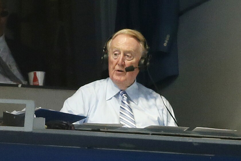Vin Scully broadcasts from the press box at Dodger Stadium during a game between the Dodgers and Colorado Rockies on Sept. 14.