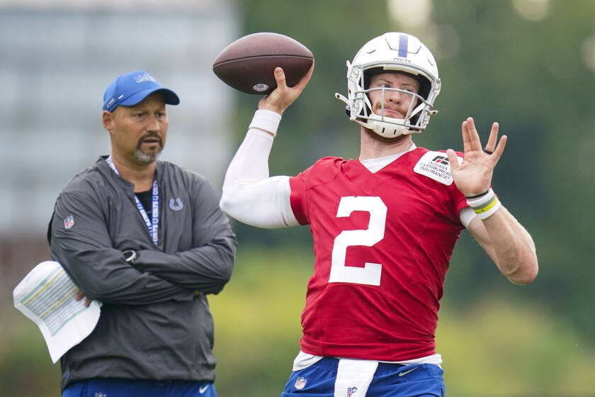 Indianapolis Colts quarterback Carson Wentz throws during practice at the NFL team's football training camp in Westfield, Ind., Thursday, July 29, 2021. (AP Photo/Michael Conroy)