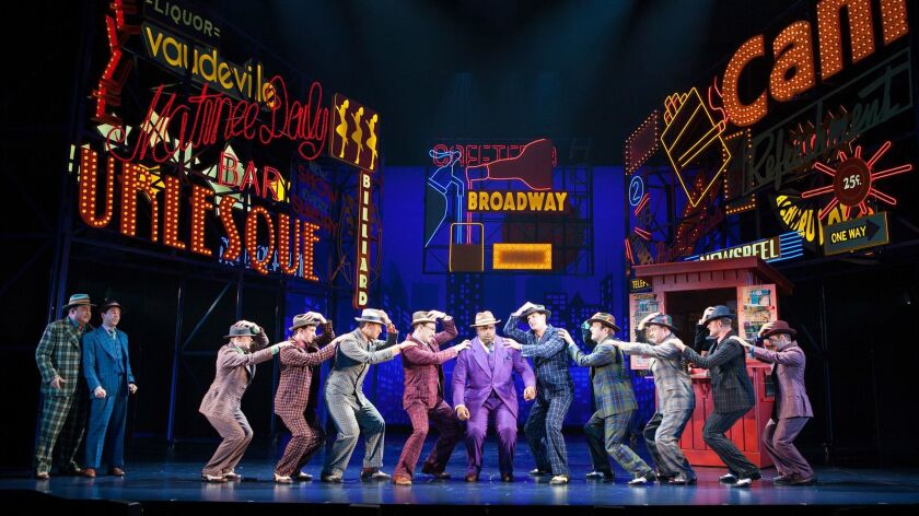 The cast of Guys and Dolls, with music and lyrics by Frank Loesser, book by Abe Burrows and Jo Swerl