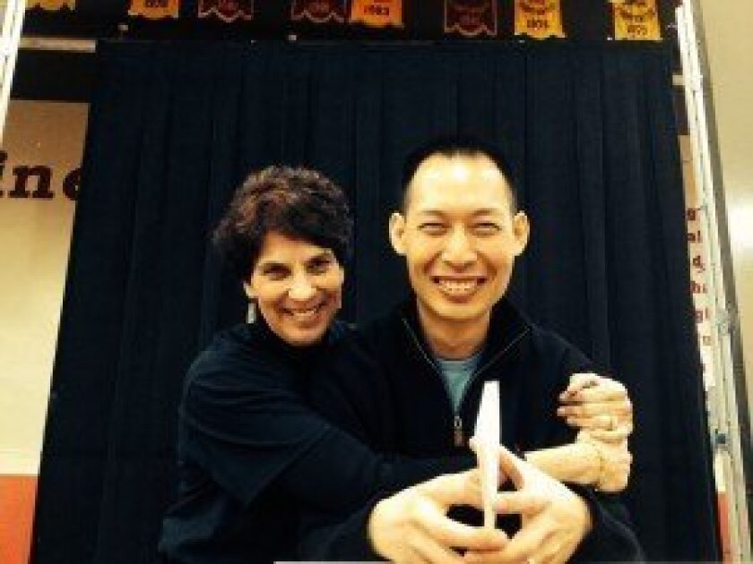Torrey Pines Yellow Ribbon Week speaker Oliver Miao with his 12th grade AP English teacher at Torrey Pines, Barbara Swovelin. Courtesy photo