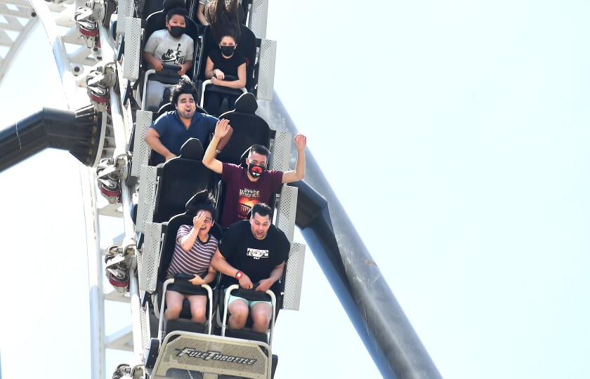 People enjoy the the Full Throttle ride at Six Flags Magic Mountain in Valencia during California reopening day.
