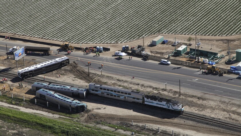 """Federal investigators will examine whether the intersection near the site of a Metrolink train derailment Tuesday was """"adequately illuminated."""""""