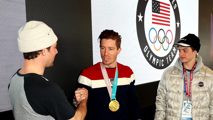 U.S. Olympians, from left, Ben Ferguson, Shaun White and Jake Pates greet one another at the U.S. house in Pyeongchang, South Korea.