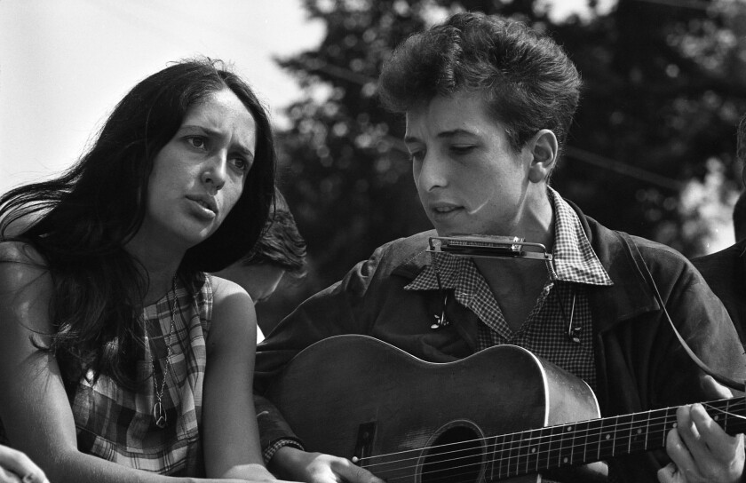 Folk singers Joan Baez and Bob Dylan performing in Washington, D.C., during the March on Washington civil rights rally on Aug. 28, 1963.