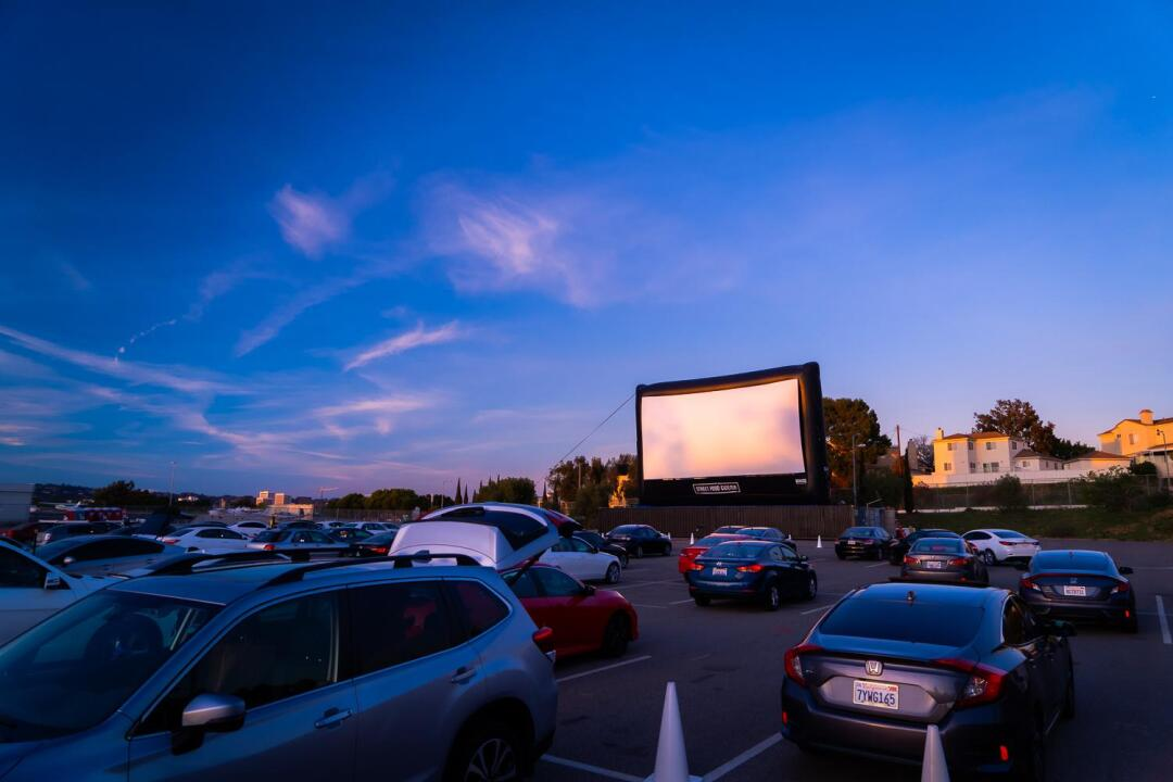 Movie screen and cars at Street Food Cinema Drive-In